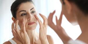 women-checking-face-on-mirror